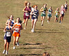 runner in the girls small high school (under 1000) reach the halfway mark at Steele Creek Park. Photo by Ned Jilton II