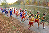 Runners in the Region D Girls Cross Country meet make their way around Oxbow Lake in St. Paul. Photo by Ned Jilton II