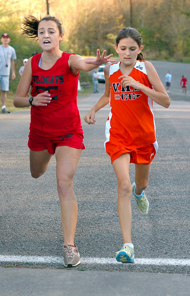 The battle for second place in the girls Region D CC meet went the the runner from VHS on the right. Photo byNed Jilton II
