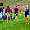 Hollidaysburg Junior Sierra McClane crosses the finish line in 1st place.