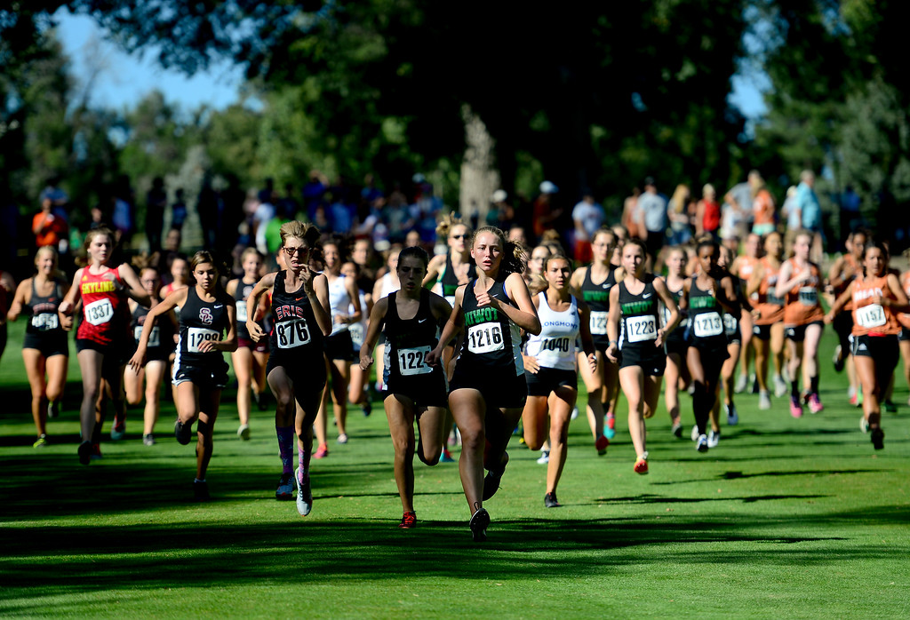 . LONGMONT, CO - SEPTEMBER 12: Runners take off from the start in the high school girls division in the RE1J District Meet at Sunset Golf Course in Longmont on Sept. 12, 2018.  (Photo by Matthew Jonas/Staff Photographer)