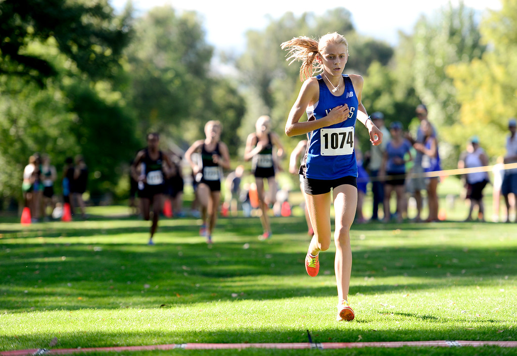. LONGMONT, CO - SEPTEMBER 12: Lyons High School\'s Quinn Gregg sprints toward the finish in the RE1J District Meet at Sunset Golf Course in Longmont on Sept. 12, 2018. Gregg finished first in the cross country meet with a time of 21:13.6. (Photo by Matthew Jonas/Staff Photographer)