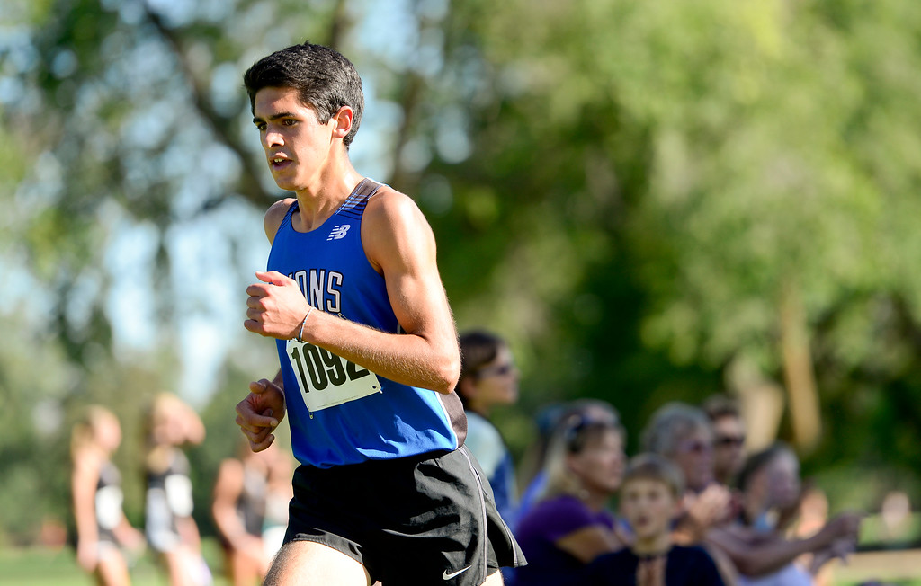 . LONGMONT, CO - SEPTEMBER 12: Lyons High School\'s  Isaac Roberts makes his way up a hill in the RE1J District Meet at Sunset Golf Course in Longmont on Sept. 12, 2018. Roberts finished with a time of 17:19.7. (Photo by Matthew Jonas/Staff Photographer)