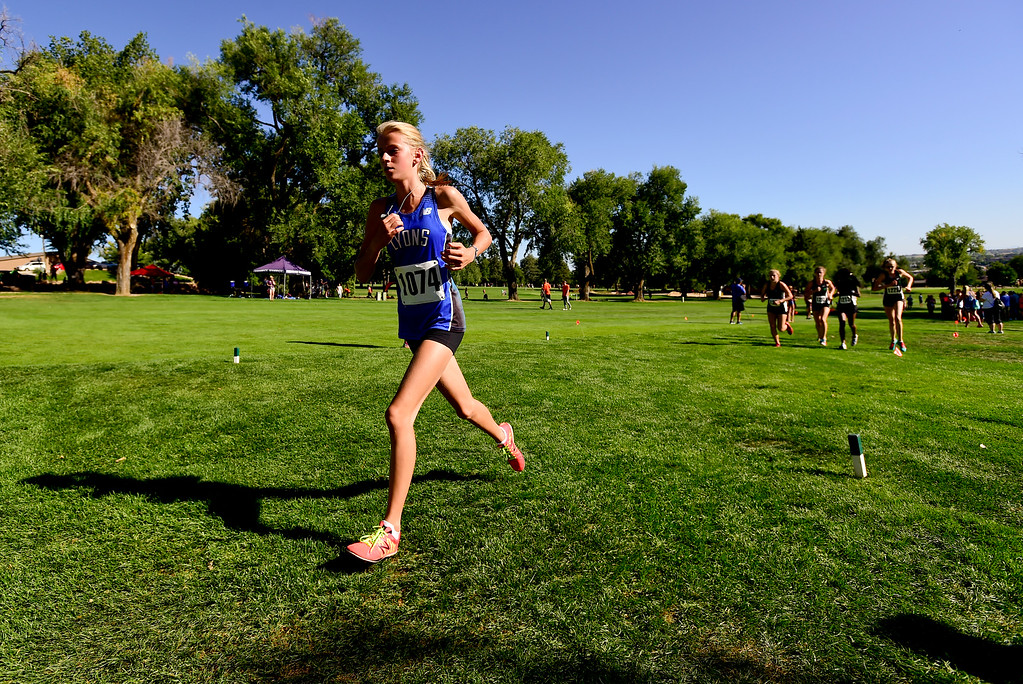 . LONGMONT, CO - SEPTEMBER 12: Lyons High School\'s Quinn Gregg makes her way up a hill in the RE1J District Meet at Sunset Golf Course in Longmont on Sept. 12, 2018. Gregg finished first in the cross country meet with a time of 21:13.6. (Photo by Matthew Jonas/Staff Photographer)