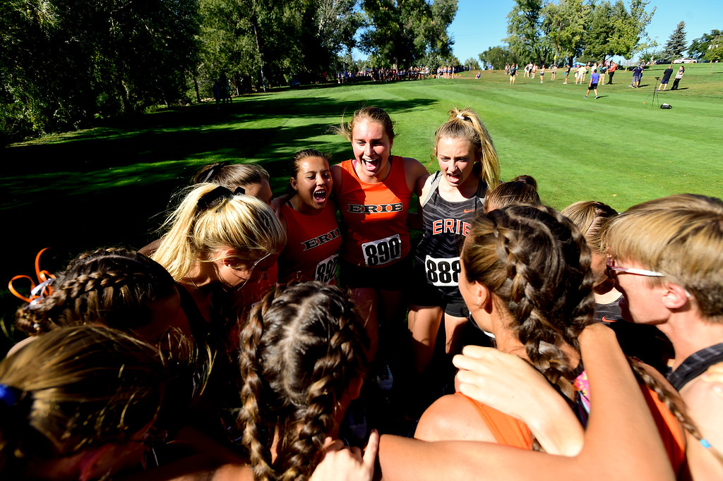 . LONGMONT, CO - SEPTEMBER 12: Erie High School\'s girls cross country team prepares for the race in the RE1J District Meet at Sunset Golf Course in Longmont on Sept. 12, 2018.  (Photo by Matthew Jonas/Staff Photographer)