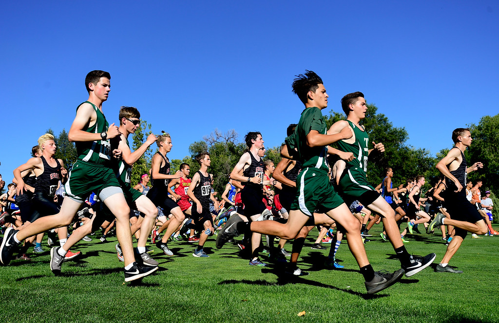. LONGMONT, CO - SEPTEMBER 12: Runners take off from the start in the high school boys division in the RE1J District Meet at Sunset Golf Course in Longmont on Sept. 12, 2018.  (Photo by Matthew Jonas/Staff Photographer)
