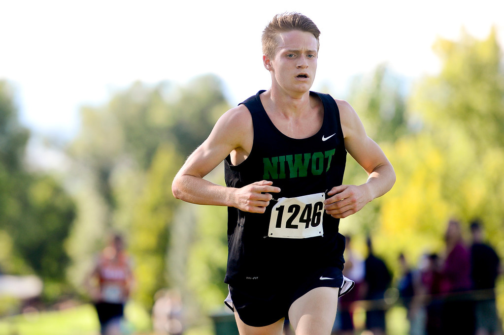 . LONGMONT, CO - SEPTEMBER 12: Niwot High School\'s Caleb Bishop crosses the finish line in the RE1J District Meet at Sunset Golf Course in Longmont on Sept. 12, 2018. Bishop finished with a time of 18:12.9, 0:53.9 seconds behind the leader. (Photo by Matthew Jonas/Staff Photographer)