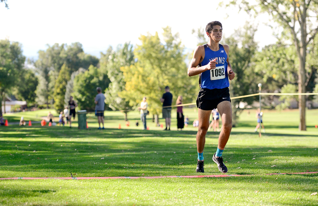 . LONGMONT, CO - SEPTEMBER 12: Lyons High School\'s  Isaac Roberts crosses the finish line in the RE1J District Meet at Sunset Golf Course in Longmont on Sept. 12, 2018. Roberts finished with a time of 17:19.7. (Photo by Matthew Jonas/Staff Photographer)
