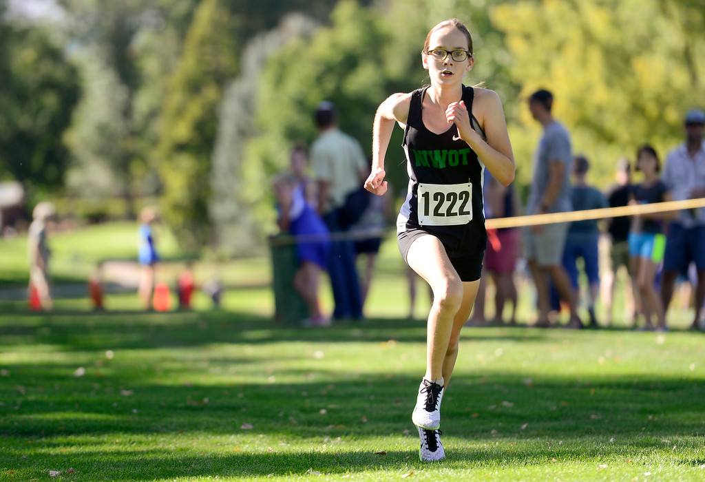 . LONGMONT, CO - SEPTEMBER 12: Niwot High School\'s Eva Klingbeil sprints toward the finish of the RE1J District Meet at Sunset Golf Course in Longmont on Sept. 12, 2018. Klingbeil finished with a time of 21:41.1, 28.1 seconds behind the leader. (Photo by Matthew Jonas/Staff Photographer)