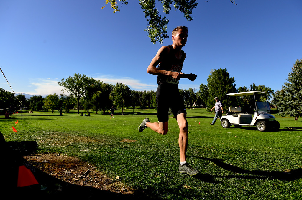 . LONGMONT, CO - SEPTEMBER 12: Eire High School\'s  Jamison Cartwright makes his way around the course in the RE1J District Meet at Sunset Golf Course in Longmont on Sept. 12, 2018. Cartwright finished with a time of 17:26.7, 0:07.7 seconds behind the leader. (Photo by Matthew Jonas/Staff Photographer)