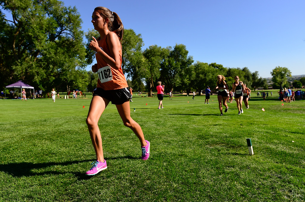 . LONGMONT, CO - SEPTEMBER 12: Mead High School\'s Kaitlynn Salazar makes her way up a hill in the RE1J District Meet at Sunset Golf Course in Longmont on Sept. 12, 2018. Salazar finished with a time of 22:46.9, 1:33.9 behind the leader. (Photo by Matthew Jonas/Staff Photographer)