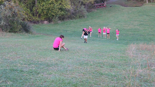 Freedom High School girls cross country coach Brent Miller promised to carry his team to their bus if they won the Dulles District title but after the Eagles won ... they made their coach carry them up the Oatlands race course biggest hill!