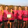 Freedom High School girls cross country team after capturing the Dulles District title on Wednesday at Oatlands outside of Leesburg, Va.