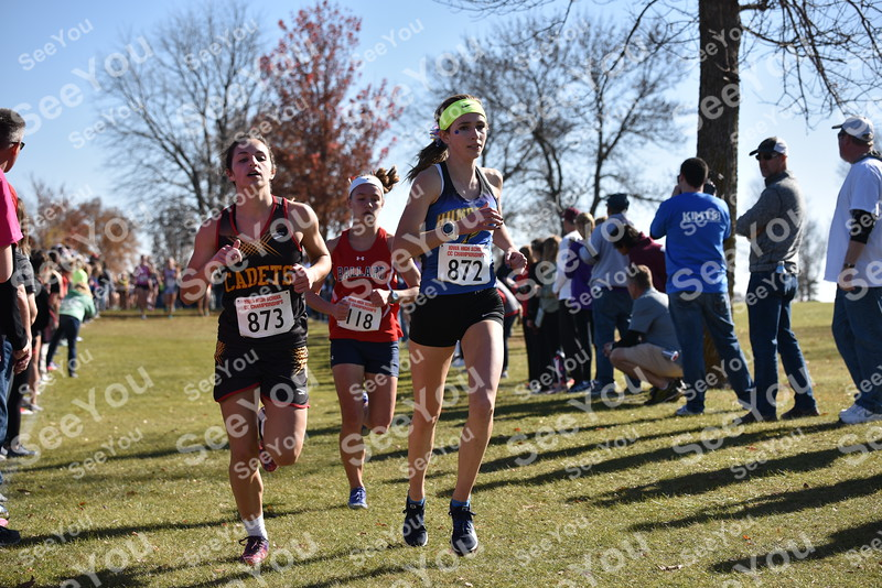 -Messenger photo by Britt Kudla<br /> Bryce Gidel of Humboldt passes Aubrie Fisher during Class 3A girls State XC on Saturday at Lakeside Golf Course