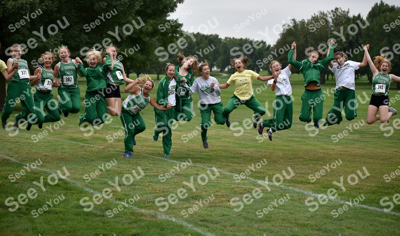 -Messenger photo by Britt Kudla<br /> St. Edmond Girls Cross Country leap for joy during Southeast Valley Invitational on Thursday at Gowrie Country Club