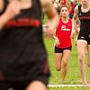 SAM HOUSEHOLDER | THE GOSHEN NEWS<br /> Goshen junior cross country runner Laura Rangel runs to the finish line during the meet against Warsaw and Elkhart Memorial Tuesday at Shanklin Park.