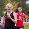SAM HOUSEHOLDER | THE GOSHEN NEWS<br /> Goshen cross country runner junior Laura Rangel runs to the finish line during the meet against Warsaw and Elkhart Memorial at Shanklin Park Tuesday.