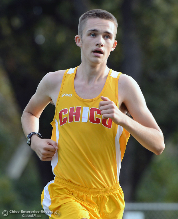 . Chico High\'s Liam Hays finishes against Pleasant Valley High varsity boys cross country race at Hooker Oak Wednesday, October 2, 2013, in Chico, Calif.  (Jason Halley/Chico Enterprise-Record)