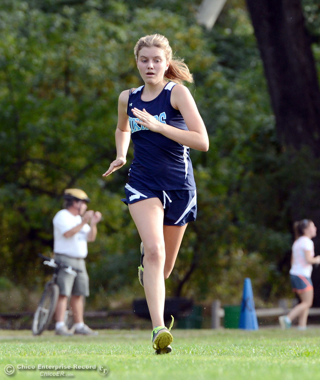 . Pleasant Valley High\'s Sacha Delong finishes against Chico High varsity girls cross country race at Hooker Oak Wednesday, October 2, 2013, in Chico, Calif.  (Jason Halley/Chico Enterprise-Record)