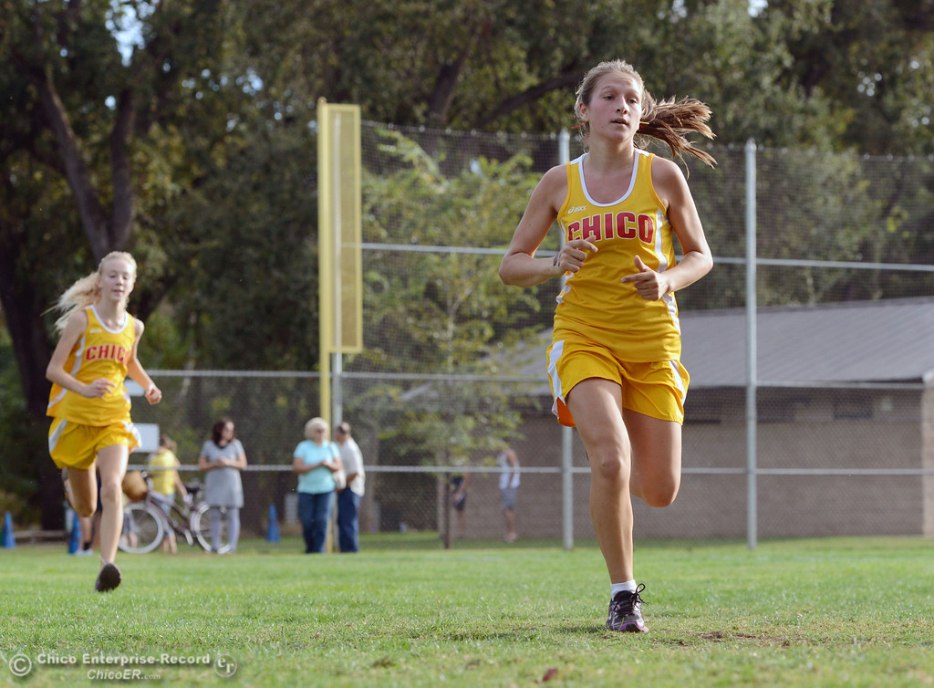 . Chico High\'s, Georgina Quinn (right), and Jessalyn Ayars (left) finish against Pleasant Valley High varsity girls cross country race at Hooker Oak Wednesday, October 2, 2013, in Chico, Calif.  (Jason Halley/Chico Enterprise-Record)