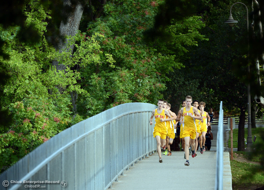 . Chico High\'s Liam Hays (left) and Jacob Graber (right) lead a pack against Pleasant Valley High varsity boys cross country race at Hooker Oak Wednesday, October 2, 2013, in Chico, Calif.  (Jason Halley/Chico Enterprise-Record)