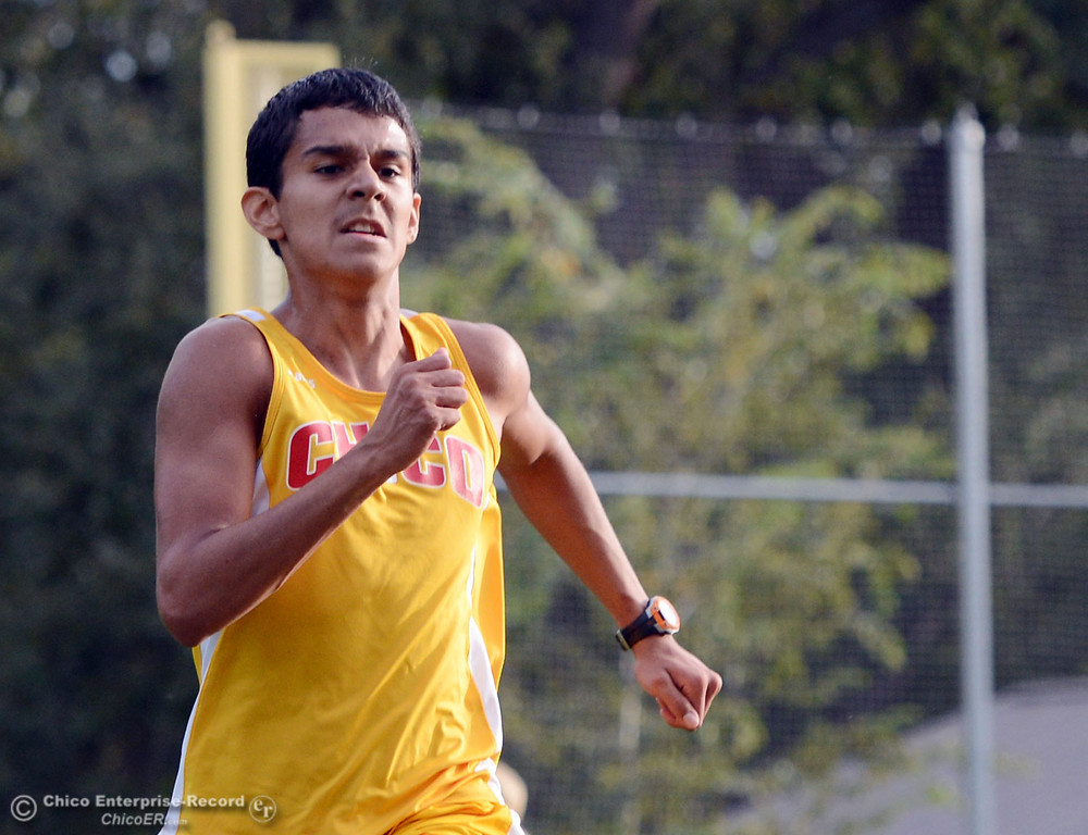 . Chico High\'s Adrian Gomez-Mora finishes against Pleasant Valley High varsity boys cross country race at Hooker Oak Wednesday, October 2, 2013, in Chico, Calif.  (Jason Halley/Chico Enterprise-Record)