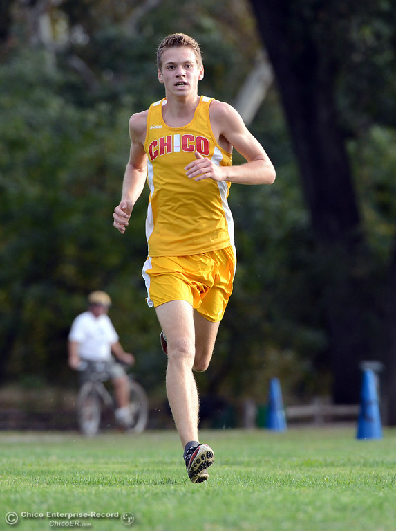 . Chico High\'s Jacob Graber finishes against Pleasant Valley High varsity boys cross country race at Hooker Oak Wednesday, October 2, 2013, in Chico, Calif.  (Jason Halley/Chico Enterprise-Record)