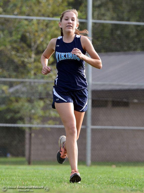 . Pleasant Valley High\'s Bryn Lawrence finishes against Chico High varsity girls cross country race at Hooker Oak Wednesday, October 2, 2013, in Chico, Calif.  (Jason Halley/Chico Enterprise-Record)