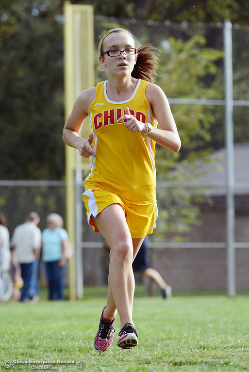 . Chico High\'s Alyson Lacko finishes first against Pleasant Valley High varsity girls cross country race at Hooker Oak Wednesday, October 2, 2013, in Chico, Calif.  (Jason Halley/Chico Enterprise-Record)