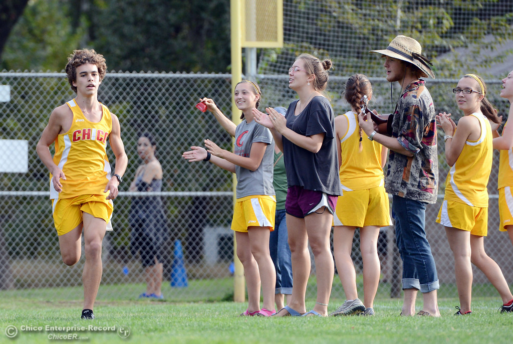 . Chico High Benton Miller finishes against Pleasant Valley High varsity boys cross country race at Hooker Oak Wednesday, October 2, 2013, in Chico, Calif.  (Jason Halley/Chico Enterprise-Record)