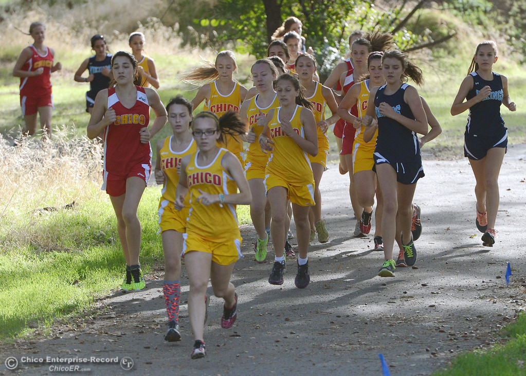 . Chico High\'s Alyson Lacko (front) leads the pack against Pleasant Valley High varsity girls cross country race at Hooker Oak Wednesday, October 2, 2013, in Chico, Calif.  (Jason Halley/Chico Enterprise-Record)
