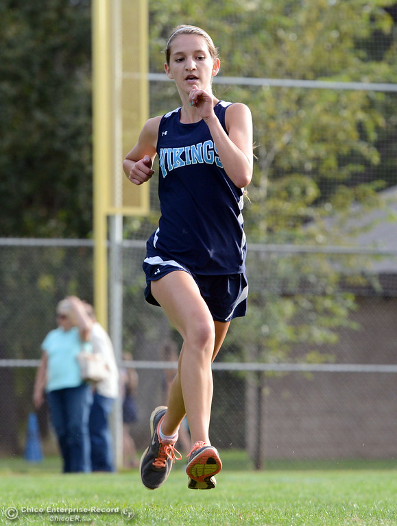 . Pleasant Valley High\'s Nicole Dully finishes against Chico High varsity girls cross country race at Hooker Oak Wednesday, October 2, 2013, in Chico, Calif.  (Jason Halley/Chico Enterprise-Record)