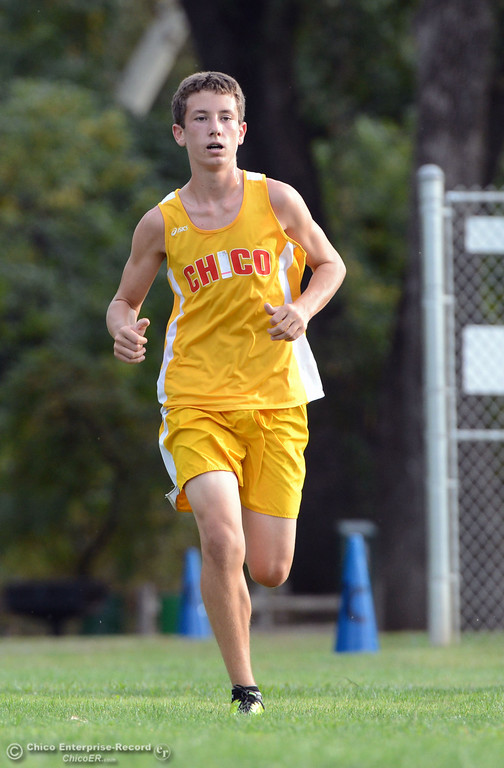 . Chico High\'s Liam Monninger finishes against Pleasant Valley High varsity boys cross country race at Hooker Oak Wednesday, October 2, 2013, in Chico, Calif.  (Jason Halley/Chico Enterprise-Record)