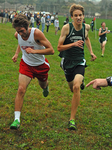 Williamsport's Brandon Fedoriw and Lewisburg's Glen Knight battle to the finish line at the cross country meet in Selinsgrove on Tuesday afternoon.