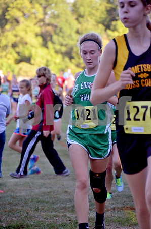 -Messenger photo by Britt Kudla<br /> Madi Reel of St. Edmond competes in the 3k run on Monday during the Humboldt Invitational