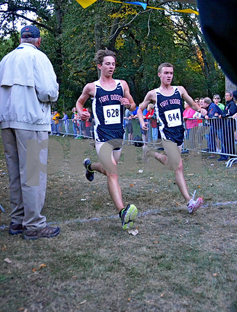 -Messenger photo by Britt Kudla<br /> Alex Jackson of Fort Dodge and teammate Thomas Thompson crosses the finish line together during Humboldt cross country Invitational on Monday at Sheldon park