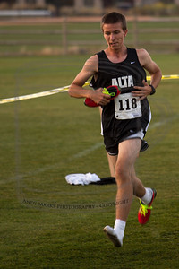 Alta's Chase, a 9th grader at a middle school that feeds into Alta, running his first varsity race with one shoe, takes last place,  extremely frustrated by the whole thing.