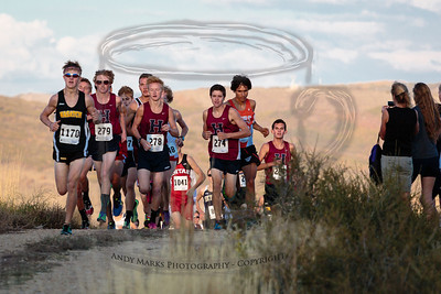Varsity Boys crest the hill as the sun dips behind a peak to the west of us.