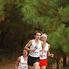 Sevier County runner still holds edge over top two Daniel Boone runners as they exit the woods onto the second level of the courst. Photo by Ned JIlton II