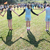 Girls in the A-AA Region 1varsity meet at Daniel Boonegather in a circle for pre-race prayer. Photo by Ned Jilton II