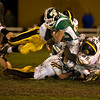 Record-Eagle/Jan-Michael Stump<br /> Traverse City Central's David Shepler (59) and Vaimagalo Taula (68) tackle Traverse City West's Josh Kingelsmith (32) in the second half of Friday's game.