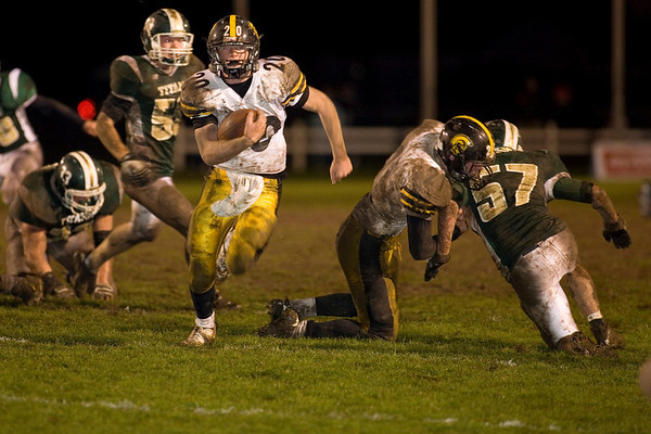 Record-Eagle/Jan-Michael Stump<br /> Traverse City Central's Derrick Rudolph (20) runs for a touchdown in the fourth quarter of Friday's win over Traverse City West.