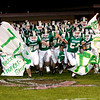Record-Eagle/Douglas Tesner<br /> <br /> Traverse City West football team breaks trough a banner at the beginning of the TCW vs TCC football game Friday night.