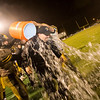 Record-Eagle/Jan-Michael Stump<br /> Traverse City Central coach Tom Passinault gets a water bath at the end of Friday's win over Traverse City West.