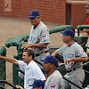 Cubs coaching staff: Manager Lou (Piniella standing), bench coach Alan Trammell (leaning).