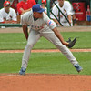 Cubs pitcher Carlos Marmol beginning his windup.