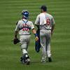 Cub catcher Geovany Soto (L) and starting pitcher Randy Wells (R) make their way in from the bullpen just prior to the start of Sunday's game.