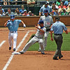 Cub 1st baseman Pena stepping on the bag to nullify Royal player's hit.