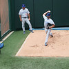 Starting pitcher for Sunday afternoon's game Randy Wells warming up in the bullpen. Cub pitching coach Jim Riggins watching his form.