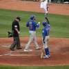 Cub catcher Geovany Soto immediately followed Ramirez's solo homer with one of his own. Here the ump watches him cross home plate after the homer. OF Alfonso Soriano raises a fist in celebration of Geo's homer.